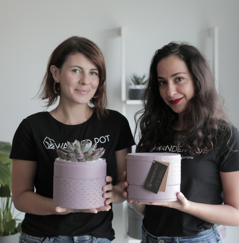 Owners of WANDER POT. Aya Samaha and Ecaterina Geru holding sustainable plant gifts made by hand and with recycled materials. Plant Gifting company in United Arab Emirates.